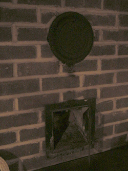 plug a leftover chimney pipe in my wall