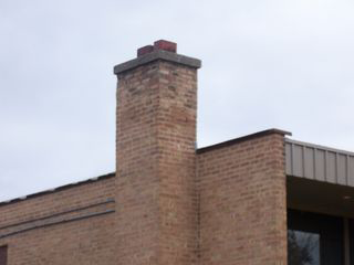 Smoke goes up the one chimney and back down the other.